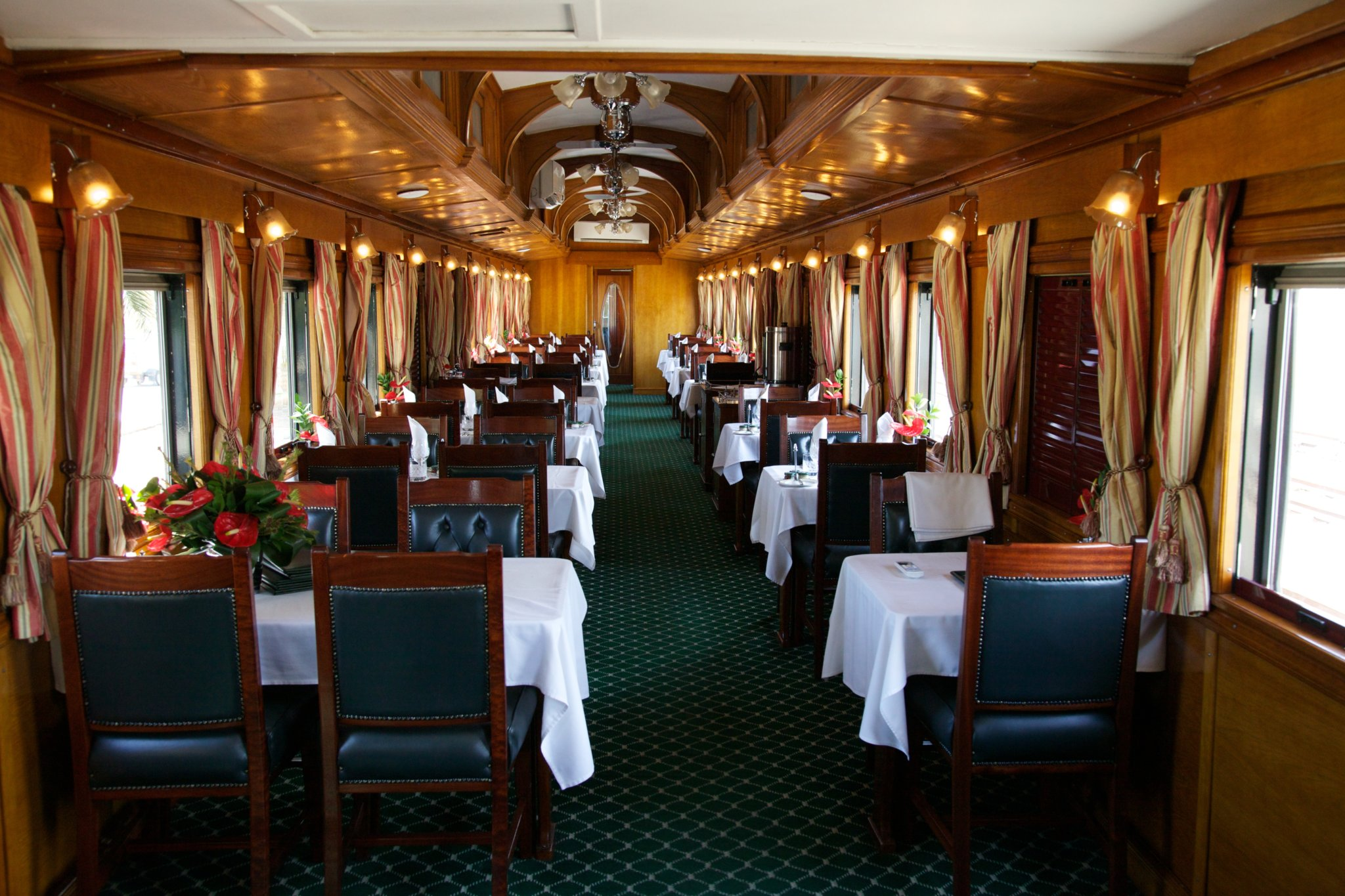 One of the dining cars in the Rovos Rail Pride of Africa all set up to serve lunch.