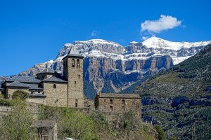 Pyrenees With Buildings Spain By Rail